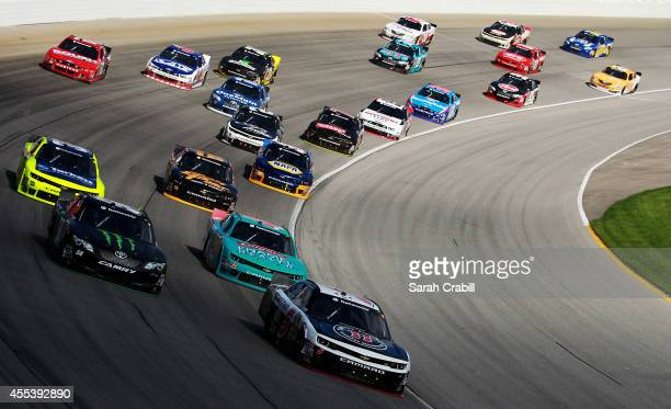 Kevin Harvick driver of the Jimmy John's Chevrolet leads a pack of cars during the NASCAR Nationwide Series Jimmy John's Freaky Fast 300 at...