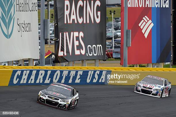 Kevin Harvick driver of the Jimmy John's Chevrolet leads Jimmie Johnson driver of the Lowe's Patriotic Chevrolet during the NASCAR Sprint Cup Series...