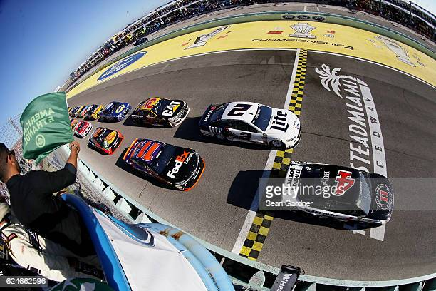Kevin Harvick driver of the Jimmy John's Chevrolet leads the field past the green flag to start the NASCAR Sprint Cup Series Ford EcoBoost 400 at...
