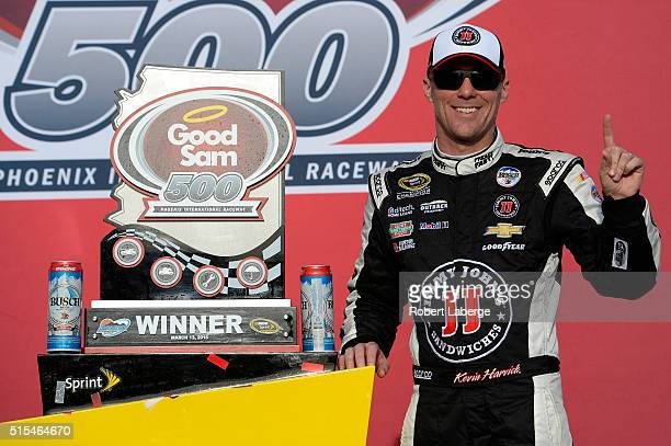 Kevin Harvick driver of the Jimmy John's Chevrolet poses in victory lane after winning the NASCAR Sprint Cup Series Good Sam 500 at Phoenix...