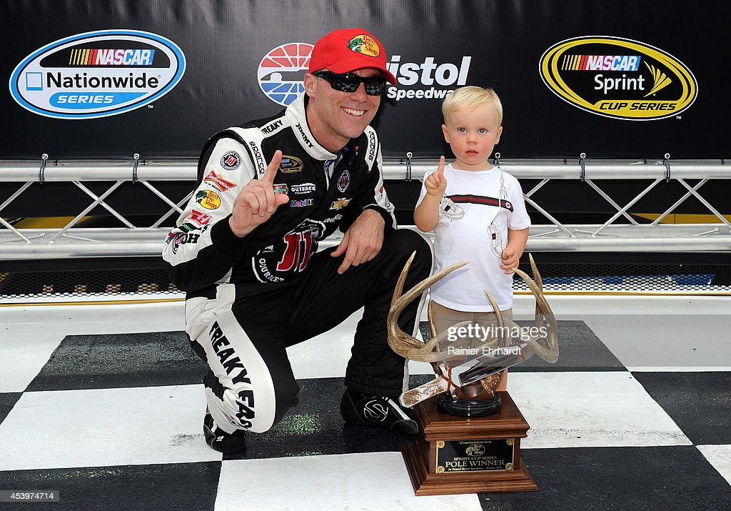 <a gi-track='captionPersonalityLinkClicked' href=/galleries/search?phrase=Kevin+Harvick&family=editorial&specificpeople=209186 ng-click='$event.stopPropagation()'>Kevin Harvick</a>, driver of the #4 Jimmy John's Chevrolet, poses with his son Keelan and the pole award after qualifying fastest for the NASCAR Sprint Cup Series Irwin Tools Night Race at Bristol Motor Speedway on August 22, 2014 in Bristol, Tennessee.