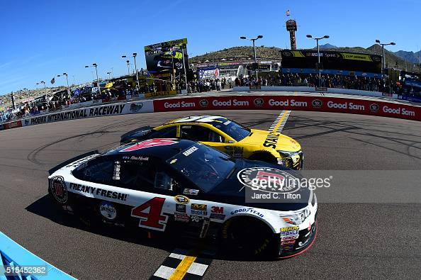 Kevin Harvick driver of the Jimmy John's Chevrolet takes the checkered flag ahead of Carl Edwards driver of the Stanley Toyota to win the NASCAR...
