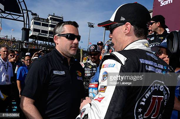 Kevin Harvick driver of the Jimmy John's Chevrolet talks to team owner Tony Stewart after winning during the NASCAR Sprint Cup Series Good Sam 500 at...