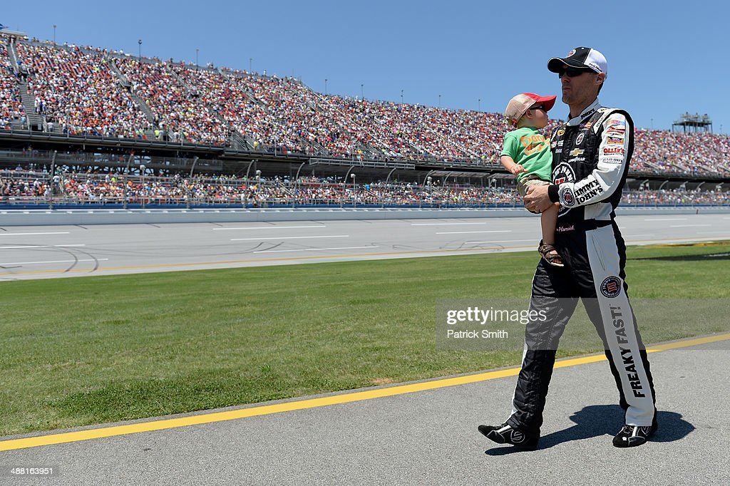 Kevin Harvick, driver of the #4 Jimmy John's Chevrolet, walks to his car with his son Keelan prior to the NASCAR Sprint Cup Series Aaron's 499 at Talladega Superspeedway on May 4, 2014 in Talladega, Alabama.