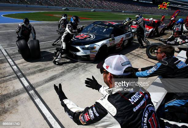 Kevin Harvick driver of the Jimmy John's Ford and Ryan Blaney driver of the Motorcraft/Quick Lane Tire Auto Center Ford pit during the Monster Energy...
