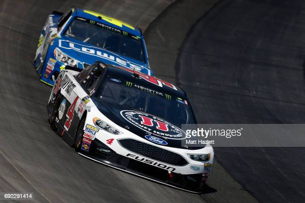 Kevin Harvick driver of the Jimmy John's Ford leads Jimmie Johnson driver of the Lowe's Chevrolet during the Monster Energy NASCAR Cup Series AAA 400...