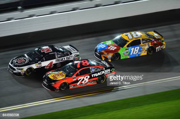 Kevin Harvick driver of the Jimmy John's Ford Martin Truex Jr driver of the Bass Pro Shops/TRACKER BOATS Toyota and Kyle Busch driver of the MM's...