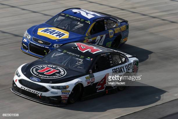 Kevin Harvick driver of the Jimmy John's Ford races Chase Elliott driver of the NAPA Chevrolet during the Monster Energy NASCAR Cup Series AAA 400...