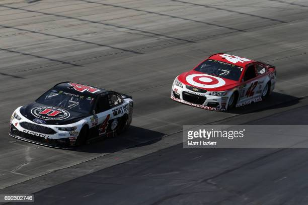 Kevin Harvick driver of the Jimmy John's Ford races Kyle Larson driver of the Target Chevrolet during the Monster Energy NASCAR Cup Series AAA 400...