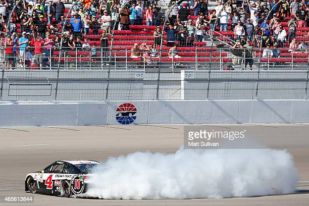 Kevin Harvick driver of the Jimmy John's/Budweiser Chevrolet celebrates with a burnout after winning the NASCAR Sprint Cup Series Kobalt 400 at Las...