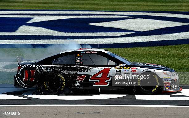 Kevin Harvick driver of the Jimmy John's/Budweiser Chevrolet is seen after celebrating with a burnout after winning the NASCAR Sprint Cup Series...