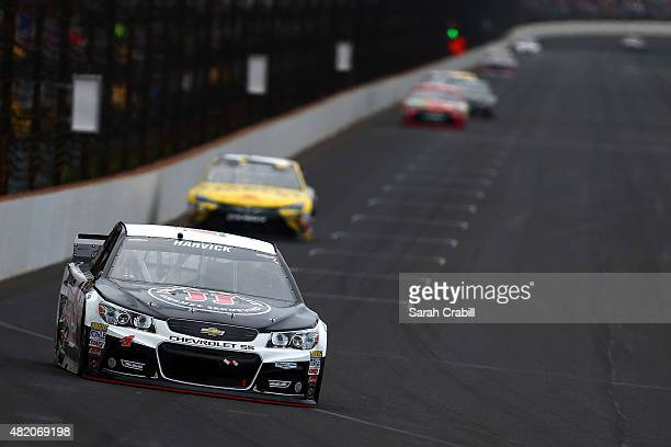 Kevin Harvick driver of the Jimmy John's/Budweiser Chevrolet leads a pack of cars during the NASCAR Sprint Cup Series Crown Royal Presents the Jeff...