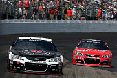 Kevin Harvick driver of the Jimmy John's/Budweiser Chevrolet leads Kurt Busch driver of the Haas Automation Chevrolet during the NASCAR Sprint Cup...
