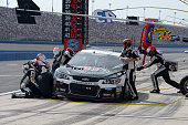 Kevin Harvick driver of the Jimmy John's/Budweiser Chevrolet pits during the NASCAR Sprint Cup Series Auto Club 400 at Auto Club Speedway on March 22...