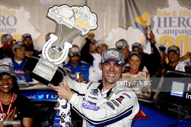 Kevin Harvick driver of the Kroger/PG Chevrolet celebrates with the trophy after winnining the NASCAR Nationwide Series John R Elliott HERO Campaign...