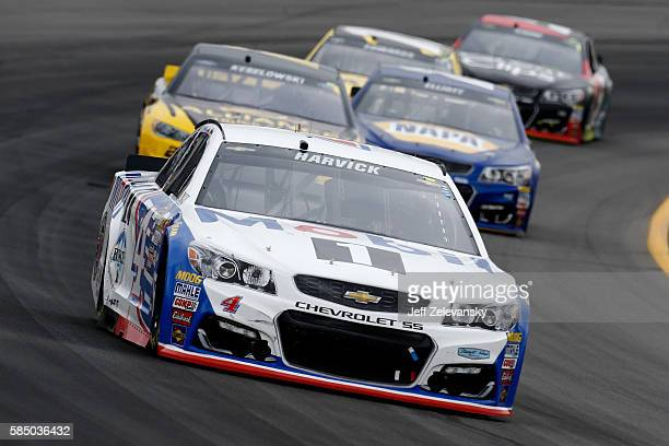 Kevin Harvick driver of the Mobil 1 Chevrolet races during the NASCAR Sprint Cup Series Pennsylvania 400 at Pocono Raceway on August 1 2016 in Long...