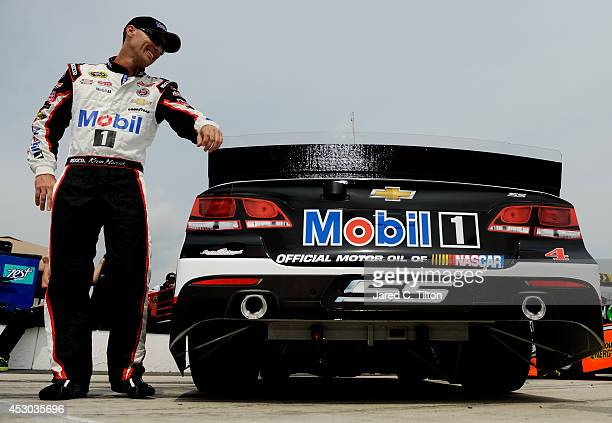Kevin Harvick driver of the Mobil 1 Chevrolet stands on the grid before qualifying for the NASCAR Sprint Cup Series GoBowlingcom 400 at Pocono...