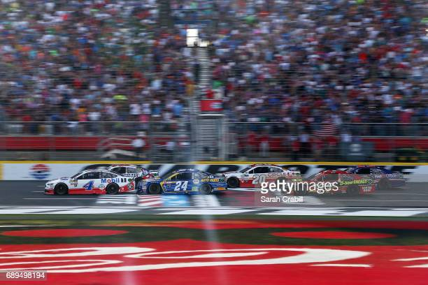 Kevin Harvick driver of the Mobil 1 Ford and Kyle Busch driver of the MM's Red White Blue Toyota take the green flag to start the Monster Energy...