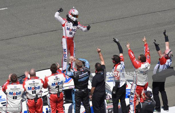 Kevin Harvick driver of the Mobil 1 Ford celebrates his victory during the Monster Energy NASCAR Cup Series Toyota/Save Mart 350 at Sonoma Raceway on...