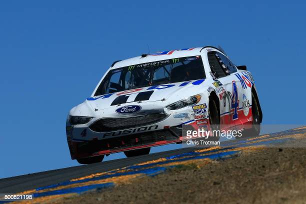 Kevin Harvick driver of the Mobil 1 Ford races during the Monster Energy NASCAR Cup Series Toyota/Save Mart 350 at Sonoma Raceway on June 25 2017 in...