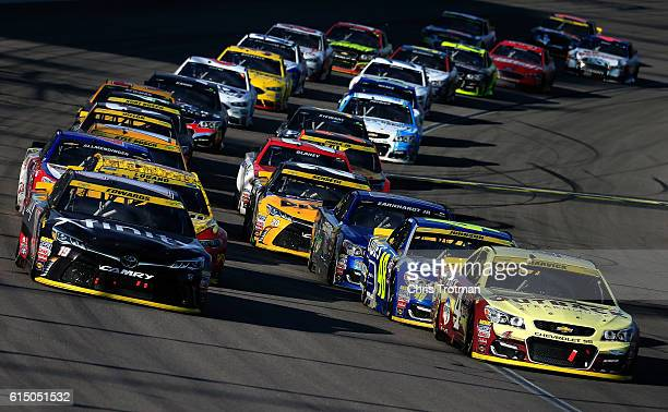 Kevin Harvick driver of the Outback Chevrolet and Carl Edwards driver of the Xfinity Toyota lead the field to the final restart during the NASCAR...