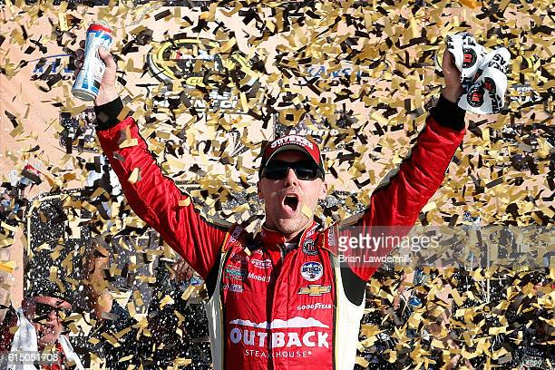 Kevin Harvick driver of the Outback Chevrolet celebrates in Victory Lane after winning the NASCAR Sprint Cup Series Hollywood Casino 400 at Kansas...