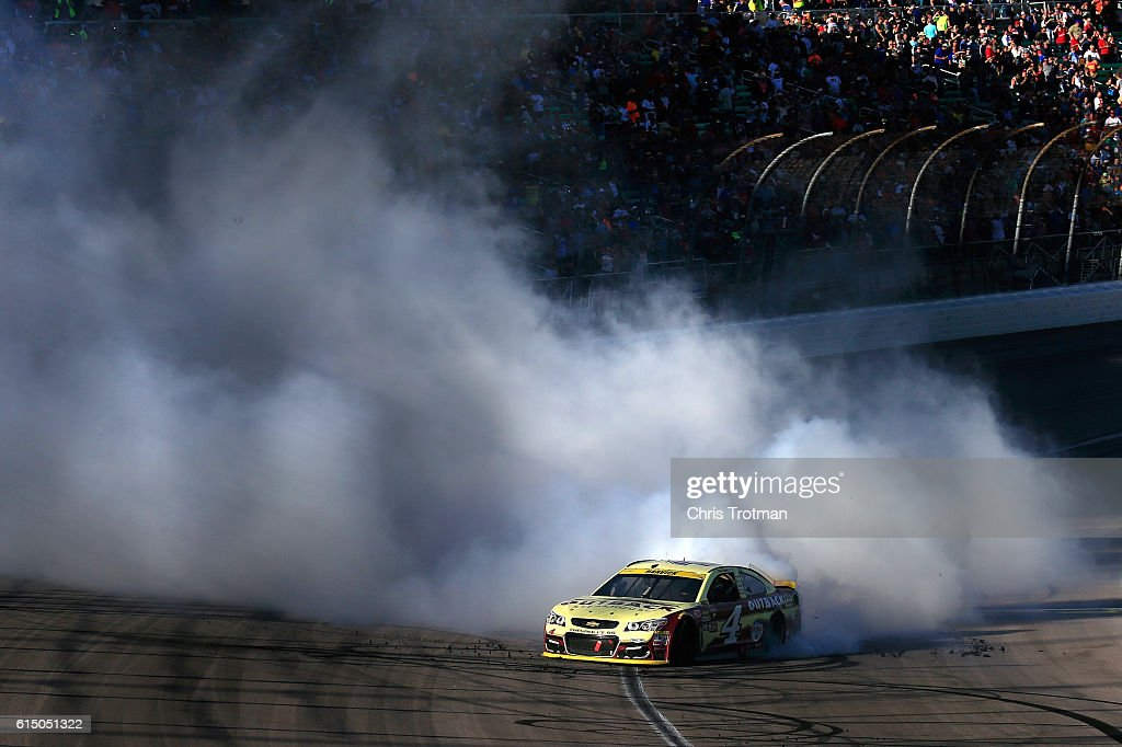 Kevin Harvick, driver of the #4 Outback Chevrolet, celebrates with a burnout after winning the NASCAR Sprint Cup Series Hollywood Casino 400 at Kansas Speedway on October 16, 2016 in Kansas City, Kansas.