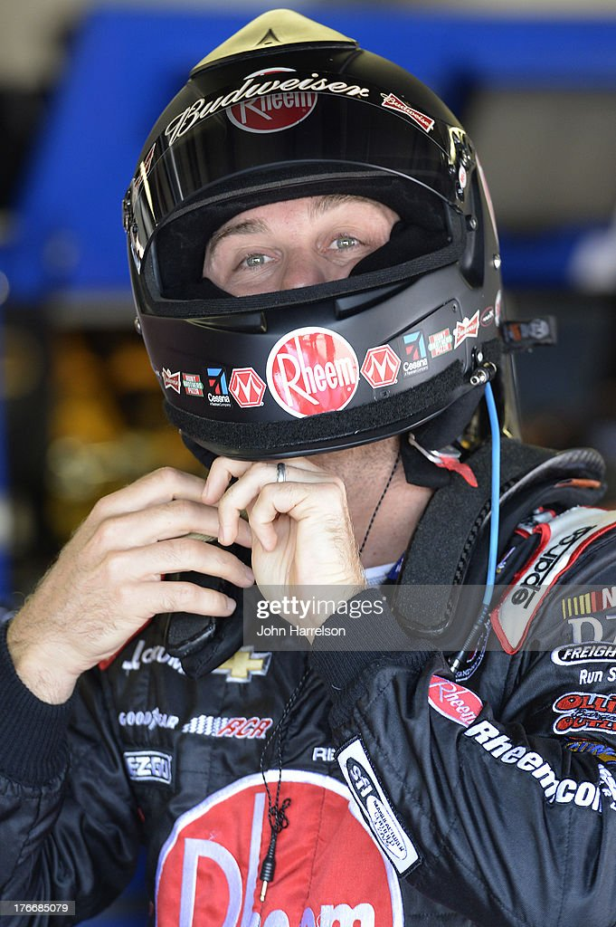 <a gi-track='captionPersonalityLinkClicked' href=/galleries/search?phrase=Kevin+Harvick&family=editorial&specificpeople=209186 ng-click='$event.stopPropagation()'>Kevin Harvick</a>, driver of the #29 Rheem Chevrolet, pulls on his helmet in the garage area during practice for the NASCAR Sprint Cup Series 44th Annual Pure Michigan 400 at Michigan International Speedway on August 17, 2013 in Brooklyn, Michigan.