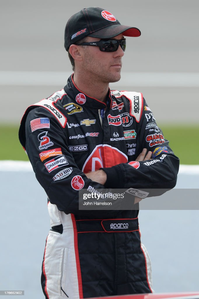 Kevin Harvick, driver of the #29 Rheem Chevrolet, stands on the grid during qualifying for the NASCAR Sprint Cup Series 44th Annual Pure Michigan 400 at Michigan International Speedway on August 16, 2013 in Brooklyn, Michigan.