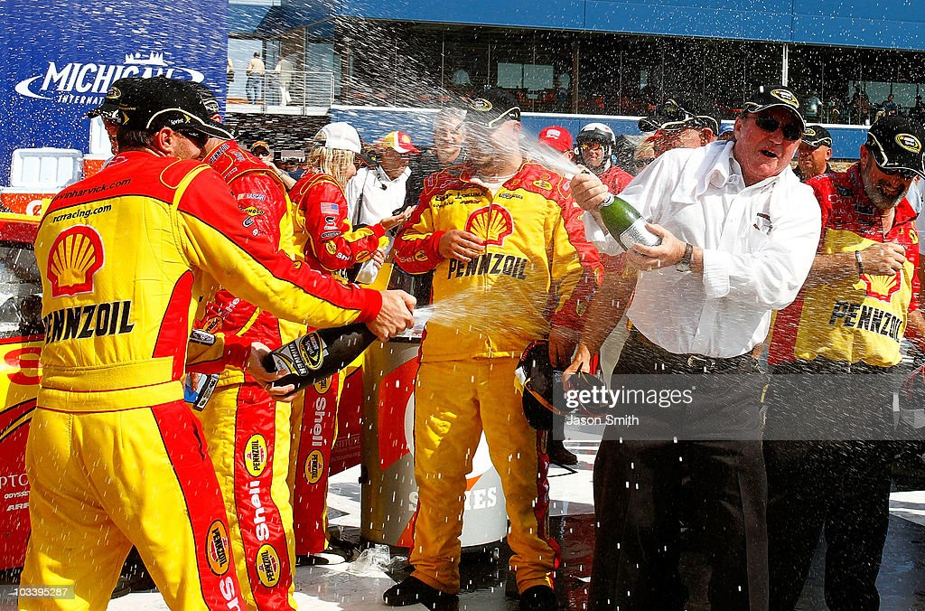 Kevin Harvick (L), driver of the #29 Shell / Pennzoil Chevrolet, celebrates with team owner Richard Childress (R) in victory lane after winning the NASCAR Sprint Cup Series CARFAX 400 at Michigan International Speedway on August 15, 2010 in Brooklyn, Michigan.