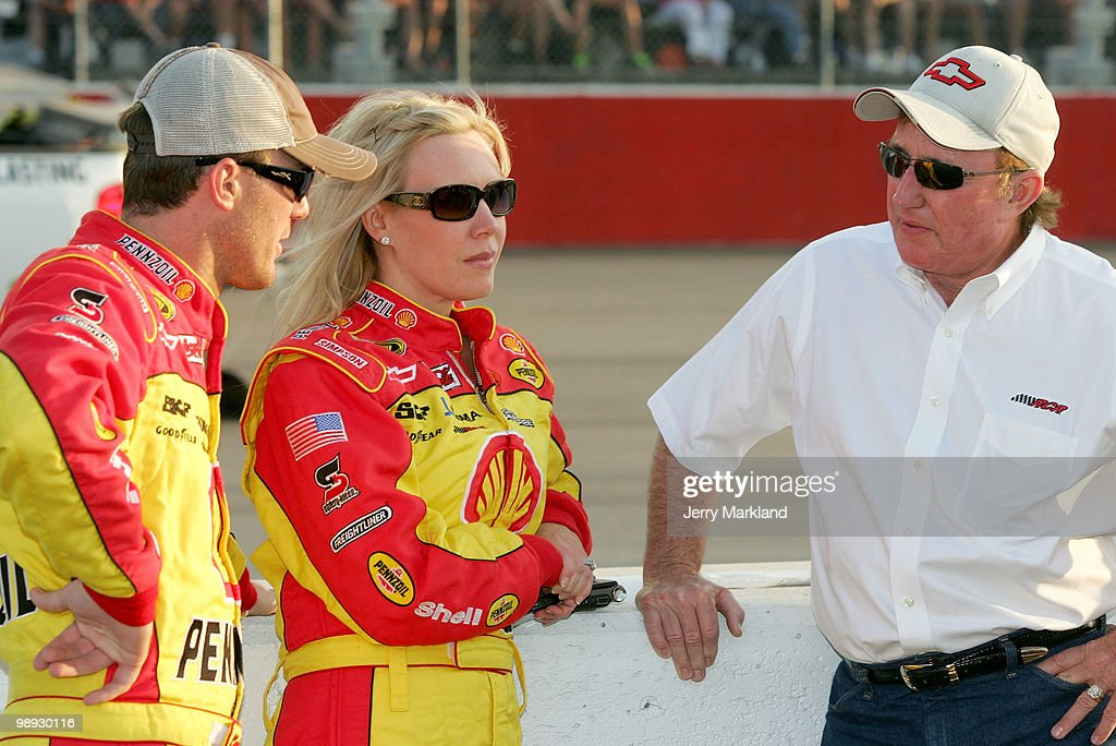 Kevin Harvick driver of the Shell / Pennzoil Chevrolet talks with his wife DeLana and team owner Richard Childress on the grid prior to the start of...