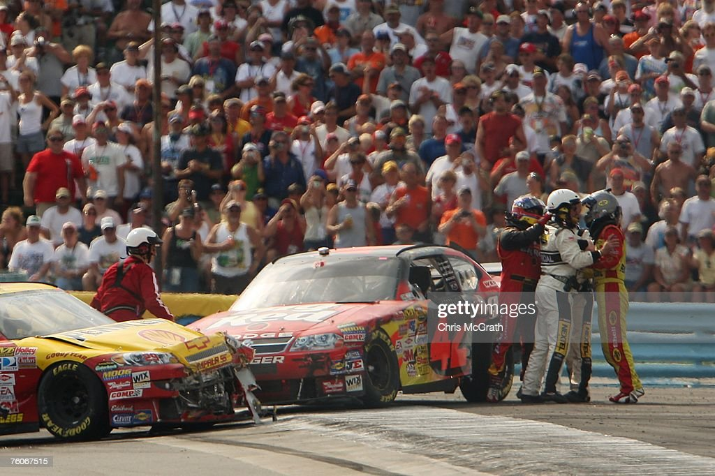 Kevin Harvick driver of the Shell/Pennzoil Chevrolet and Juan Pablo Montoya driver of the Wrigley's Big Red Dodge are separated by NASCAR officials...