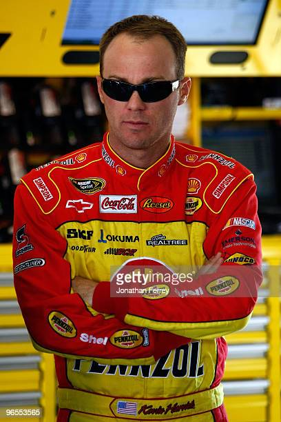Kevin Harvick driver of the Shell/Pennzoil Chevrolet looks on in the garage during practice for the NASCAR Sprint Cup Series Daytona 500 at Daytona...