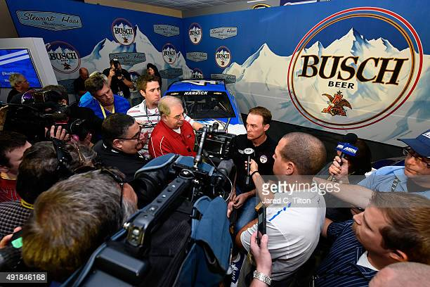 Kevin Harvick driver of the StewartHaas Racing Chevrolet answers questions from the media during a press conference with Busch and StewartHaas Racing...