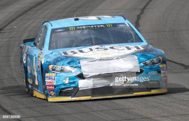 Kevin Harvick in the car goes around turn 4 with damage down to his front bumper after a second lap crash during the Monster Energy Cup Series 20th...