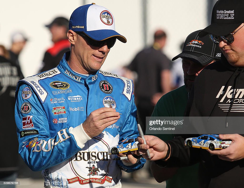 Kevin Harvick signs autographs in the garage area at Daytona International Speedway in Daytona Beach, Fla., on Friday, Feb. 12, 2016.