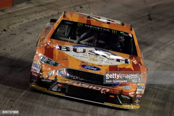 Kevin Harvick StewartHaas Racing Ford Fusion works at the steering wheel coming off of the corner during the Bass Pro Shops NRA Night Race on August...