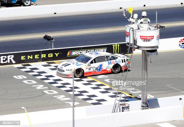 Kevin Harvick takes the combo yellow and checkered flag at the NASCAR Monster Energy Cup Series Toyota/Save Mart 350 on June 25 2017 at Sonoma...