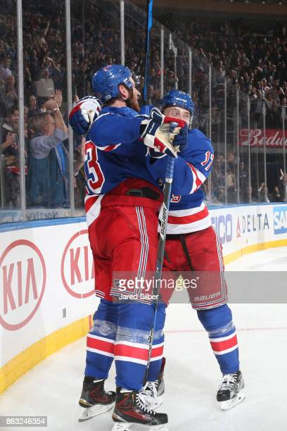 Kevin Hayes and Jesper Fast of the New York Rangers celebrate after scoring a goal in the third period against the New York Islanders at Madison...