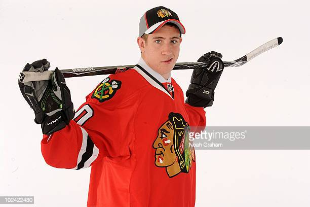 Kevin Hayes drafted 24th overall by the Chicago Blackhawks poses on stage during the 2010 NHL Entry Draft at Staples Center on June 25 2010 in Los...