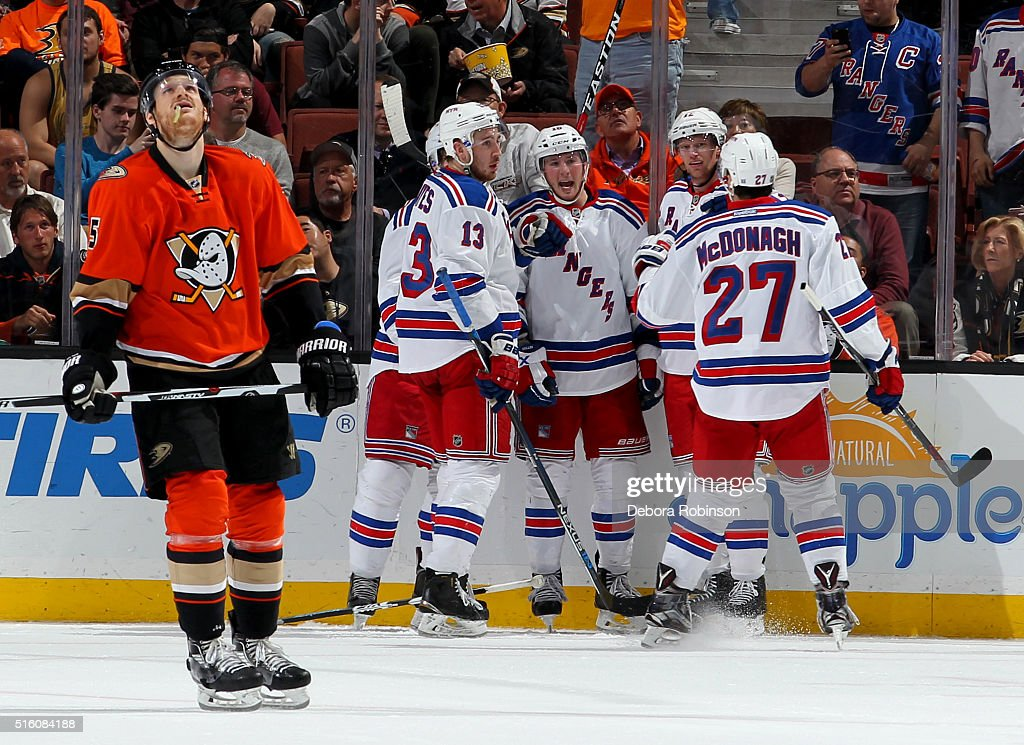 Kevin Hayes #13, Kevin Klein #8, J.T. Miller #10, Eric Staal #12 and Ryan McDonagh #27 of the New York Rangers celebrate Klein's third period goal as Korbinian Holzer #5 of the Anaheim Ducks skates away on March 16, 2016 at Honda Center in Anaheim, California.