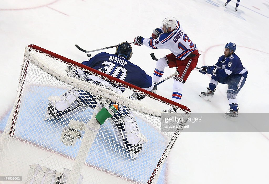 <a gi-track='captionPersonalityLinkClicked' href=/galleries/search?phrase=Kevin+Hayes+-+Ice+Hockey+Player&family=editorial&specificpeople=13635523 ng-click='$event.stopPropagation()'>Kevin Hayes</a> #13 of the New York Rangers carries the puck in on <a gi-track='captionPersonalityLinkClicked' href=/galleries/search?phrase=Ben+Bishop&family=editorial&specificpeople=700137 ng-click='$event.stopPropagation()'>Ben Bishop</a> #30 of the Tampa Bay Lightning in Game Four of the Eastern Conference Finals during the 2015 NHL Stanley Cup Playoffs at Amalie Arena on May 22, 2015 in Tampa, Florida. The Rangers defeated the Lighjtning 5-1.