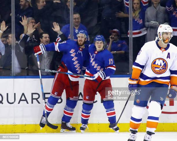 Kevin Hayes of the New York Rangers celebrates his game tying goal at 1406 of the third period against the New York Islanders as he is joined by...
