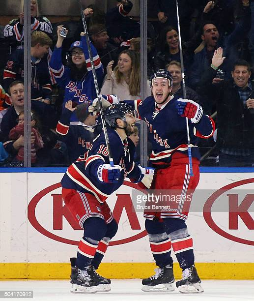 Kevin Hayes of the New York Rangers celebrates his goal at 948 of the third period against the Washington Capitals and is joined by Derick Brassard...