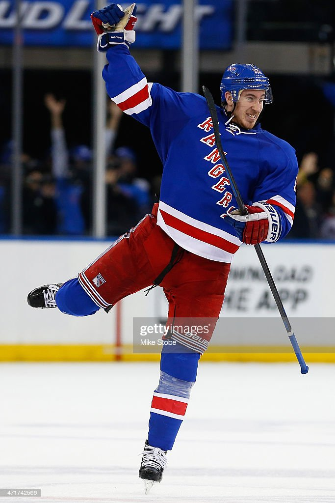 <a gi-track='captionPersonalityLinkClicked' href=/galleries/search?phrase=Kevin+Hayes+-+Ice+Hockey+Player&family=editorial&specificpeople=13635523 ng-click='$event.stopPropagation()'>Kevin Hayes</a> #13 of the New York Rangers celebrates teammate Jesper Fast #19 goal at 15:28 in the third quater against the Washington Capitals in Game One of the Eastern Conference Semifinals during the 2015 NHL Stanley Cup Playoffs at Madison Square Garden on April 30, 2015 in New York City. Capitals defeated the Rangers 2-1.