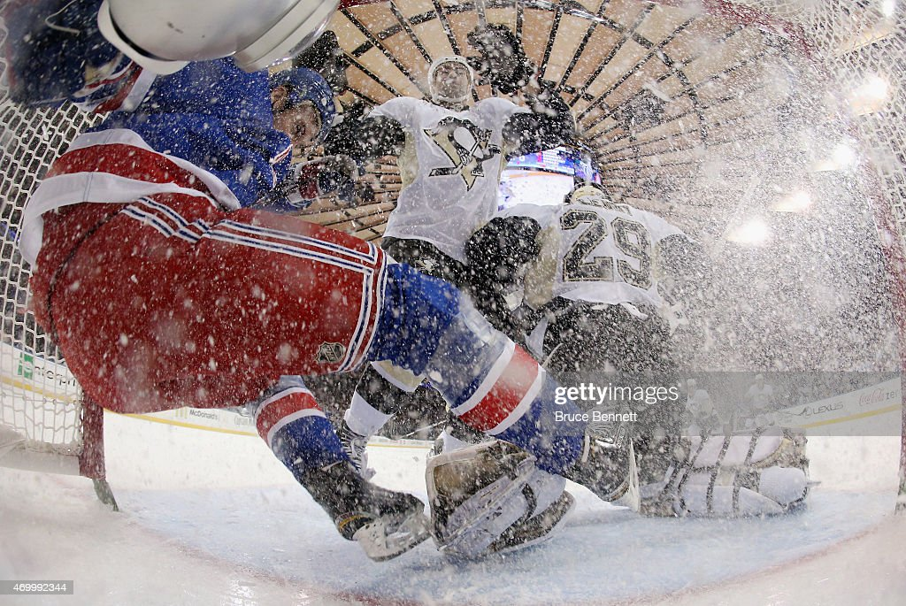 <a gi-track='captionPersonalityLinkClicked' href=/galleries/search?phrase=Kevin+Hayes+-+Ice+Hockey+Player&family=editorial&specificpeople=13635523 ng-click='$event.stopPropagation()'>Kevin Hayes</a> #13 of the New York Rangers is checked into the net during the first period against the Pittsburgh Penguins in Game One of the Eastern Conference Quarterfinals during the 2015 Stanley Cup Playoffs at Madison Square Garden on April 16, 2015 in New York City. The Rangers defeated the Penguins 2-1.