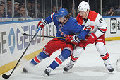 Kevin Hayes of the New York Rangers protects the puck against Alexander Semin of the Carolina Hurricanes at Madison Square Garden on December 21 2014...