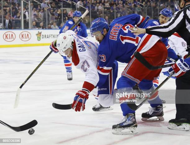 Kevin Hayes of the New York Rangers trips up Alex Galchenyuk of the Montreal Canadiens during the first period in Game Three of the Eastern...