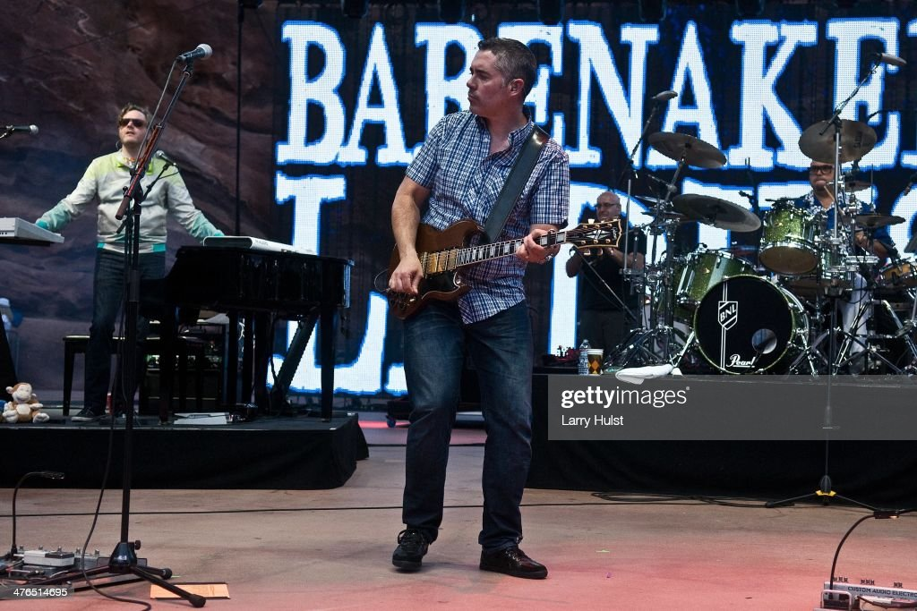 Kevin Hearn Ed Robertson and Tyler Stewart playing with 'Barenaked Ladies' ' performing at Red Rocks Amphitheatre in Morrison Colorado on June 9 2012
