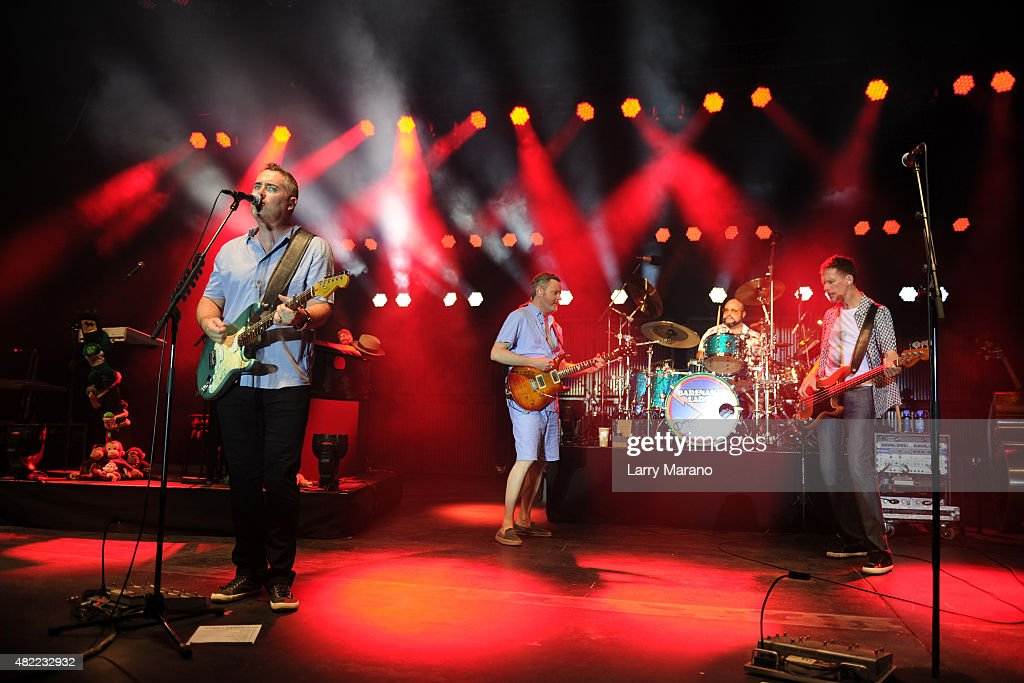 Kevin Hearn Ed Robertson Tyler Stewart and Jim Creeggan of Barenaked Ladies perform at the Sunset Cove Amphitheatre on July 10 2015 in Boca Raton...